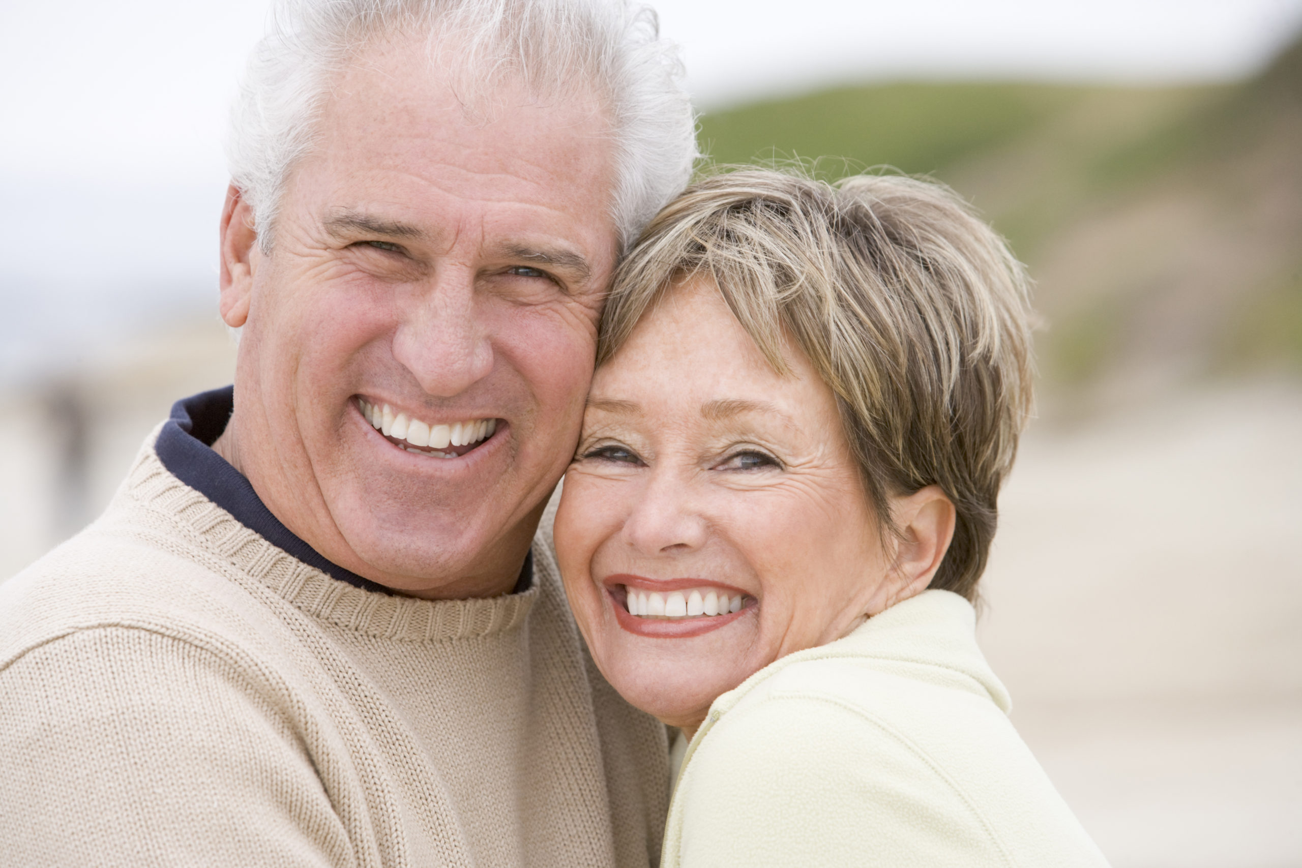 Couple at the beach smiling
